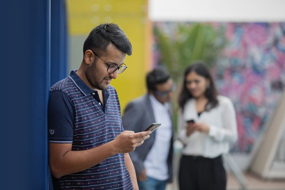 man and friends on mobile phones